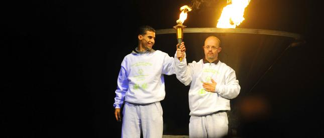 Two men carrying the torch